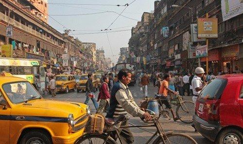 Jetsetter Guides outdoor car building street road City mode of transport transport Town neighbourhood pedestrian traffic vehicle rickshaw infrastructure busy