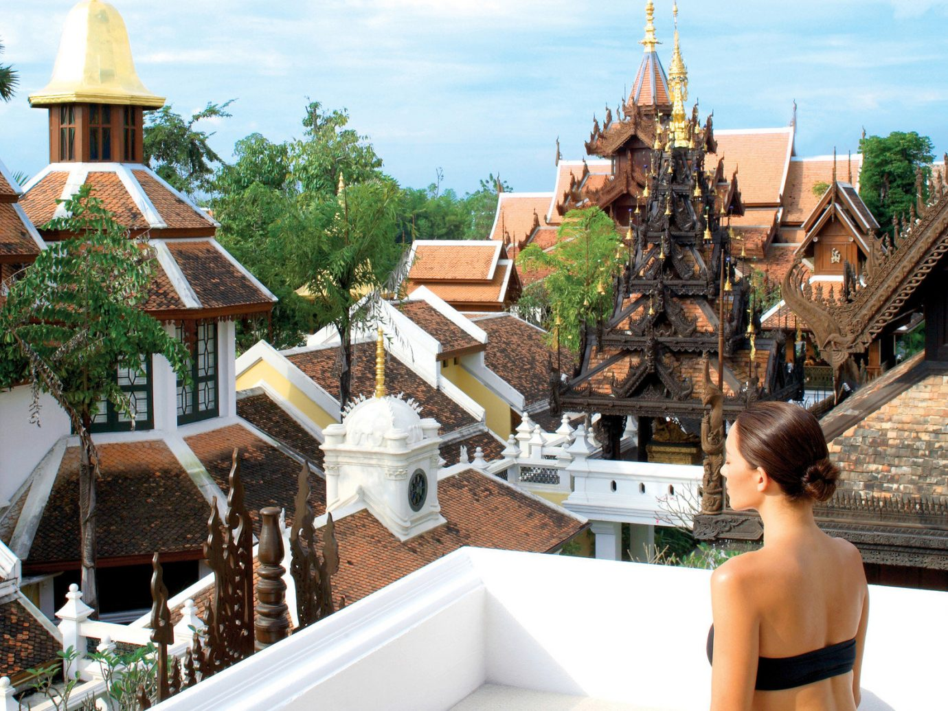 Health + Wellness Hotels Spa Retreats outdoor person building vacation temple wat Resort place of worship travel amusement park