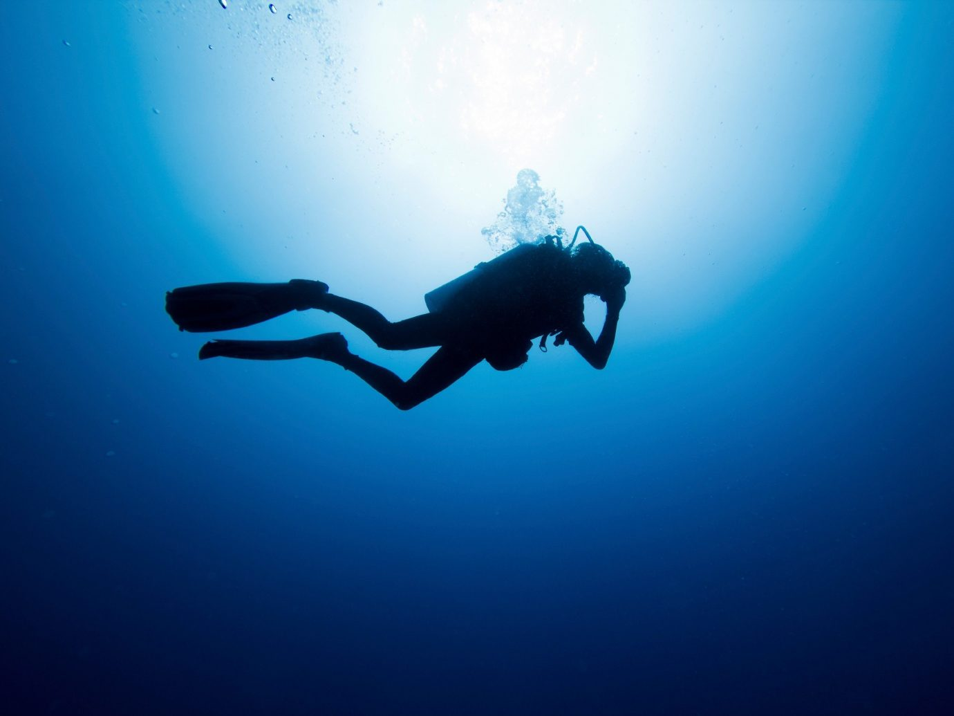 Arts + Culture Offbeat Scuba Diving + Snorkeling Trip Ideas water sport underwater diving blue swimming underwater outdoor Sport freediving diving sports outdoor recreation recreation extreme sport Scuba Diving computer wallpaper ocean floor