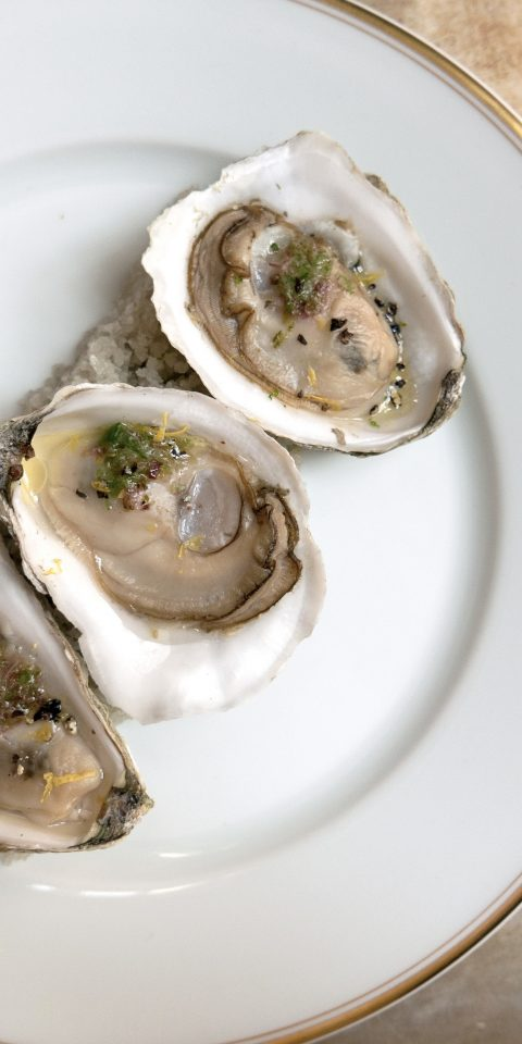 Food + Drink Romance Style + Design plate table food dish oyster Seafood invertebrate fish animal source foods mussel clams oysters mussels and scallops escargot meal meat
