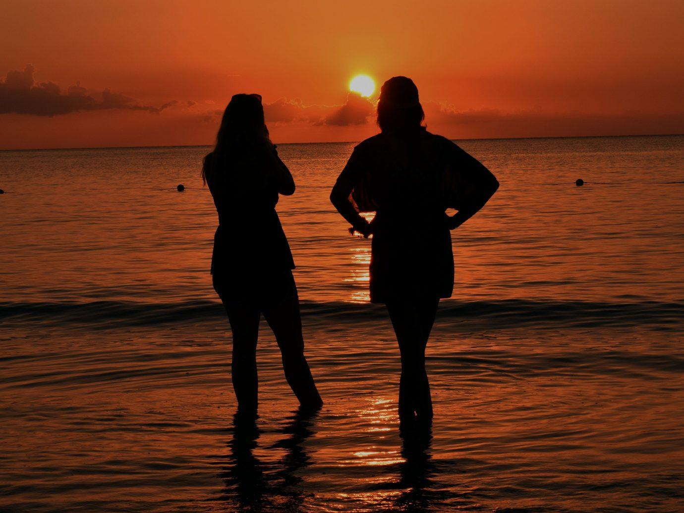 Hotels water outdoor sky Sunset Beach ground person Sea horizon Ocean Sun reflection silhouette morning evening sunrise dawn dusk sunlight Coast wave shore distance