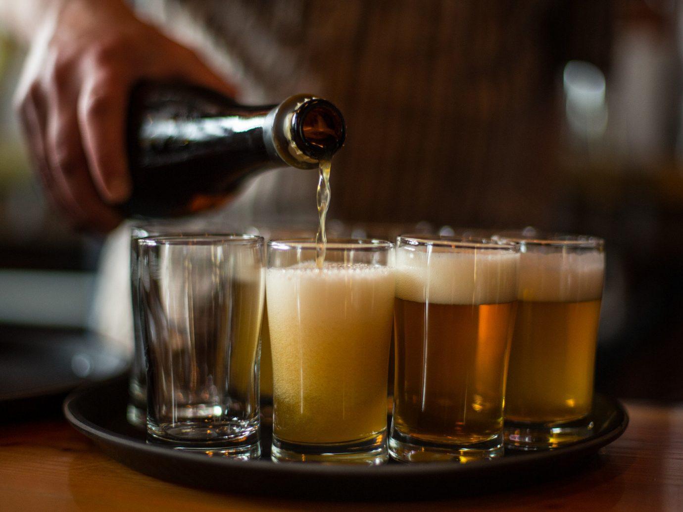 bartender beer draft Drink drinks Food + Drink people pouring table cup indoor alcoholic beverage distilled beverage glass alcohol beer cocktail liqueur beverage whisky cocktail pint us