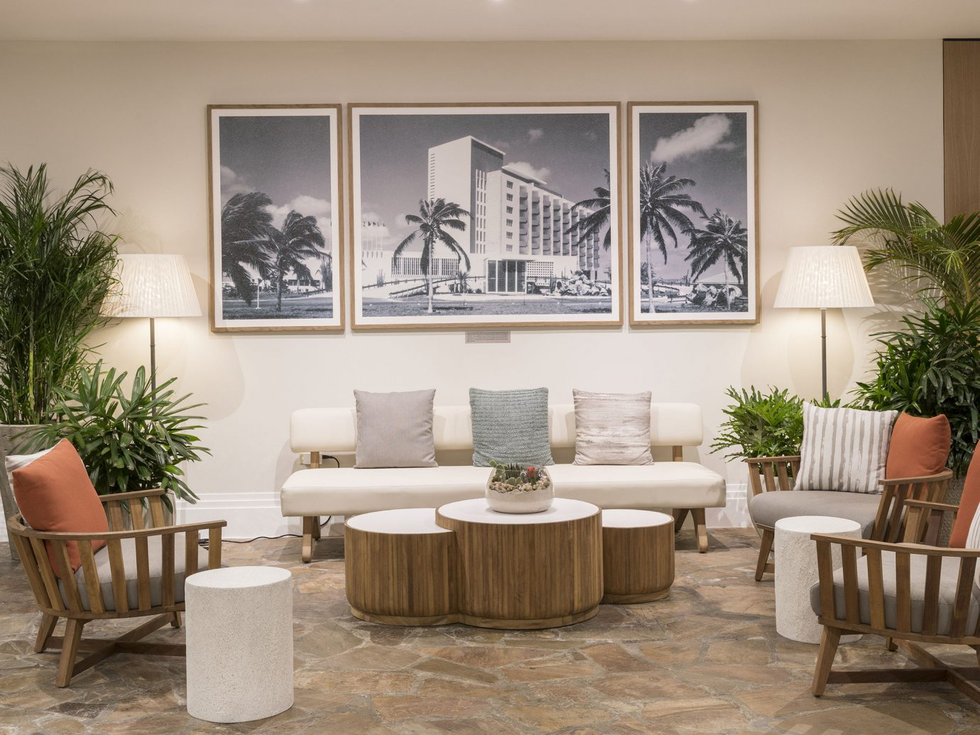 Aruba caribbean Hotels floor Living wall room indoor living room dining room chair property ceiling furniture home interior design plant table estate wood Design window covering area Lobby decorated dining table arranged
