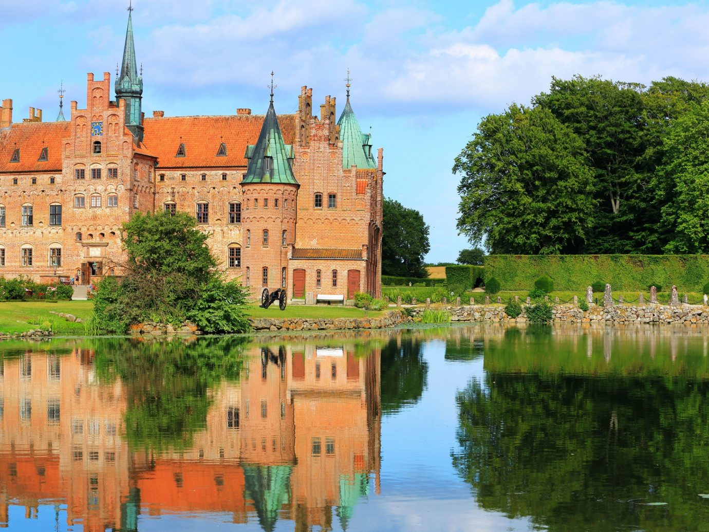 Travel Tips tree sky grass water outdoor castle building water castle château River reflection moat estate waterway stately home old palace surrounded