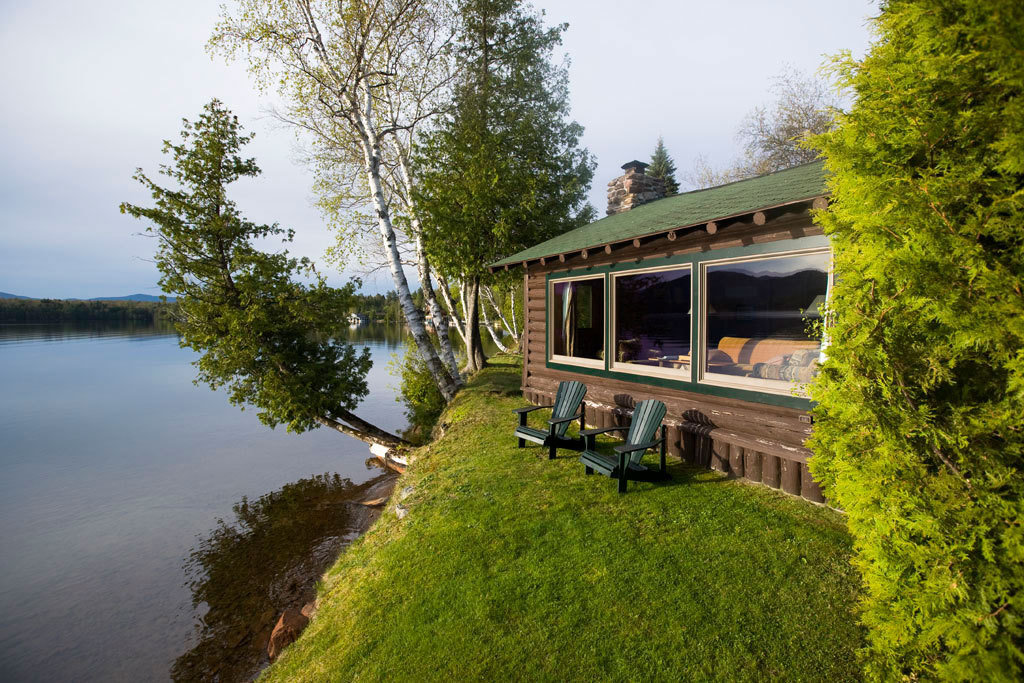 Cabin cozy Hotels Lake Lakes + Rivers Lodge Mountains Nature New York outdoor seating Outdoors remote Romantic Hotels Scenic views tree trees view viewpoint outdoor sky transport River house waterway rolling stock Canal estate rural area green traveling cottage Forest old bushes hillside surrounded Garden