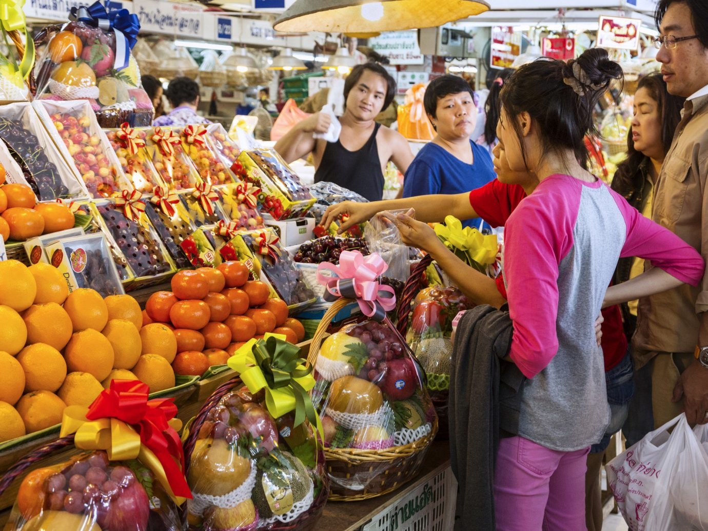 Food + Drink person marketplace market fruit public space City vendor human settlement bazaar grocery store supermarket scene food greengrocer produce retail stall store fresh sale variety