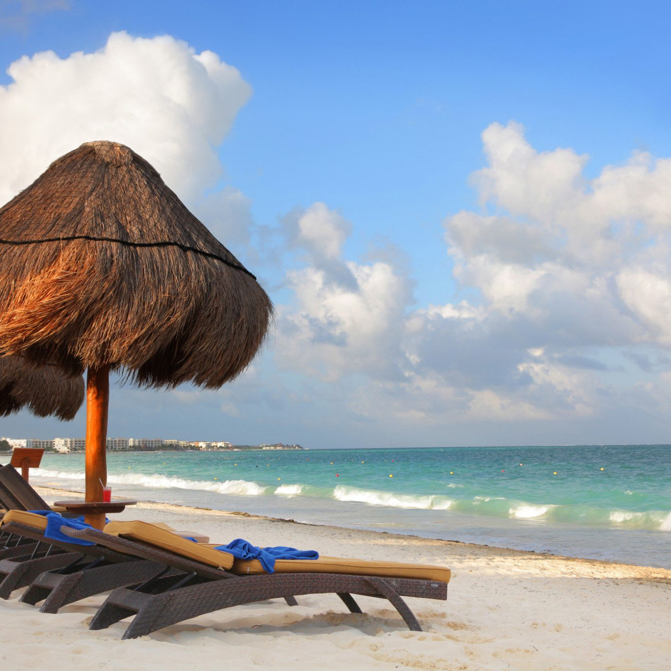 All-Inclusive Resorts Hotels sky outdoor water Beach ground umbrella Nature body of water Sea chair vacation caribbean cloud tropics shore coastal and oceanic landforms Ocean tourism Coast leisure sand sandy day distance