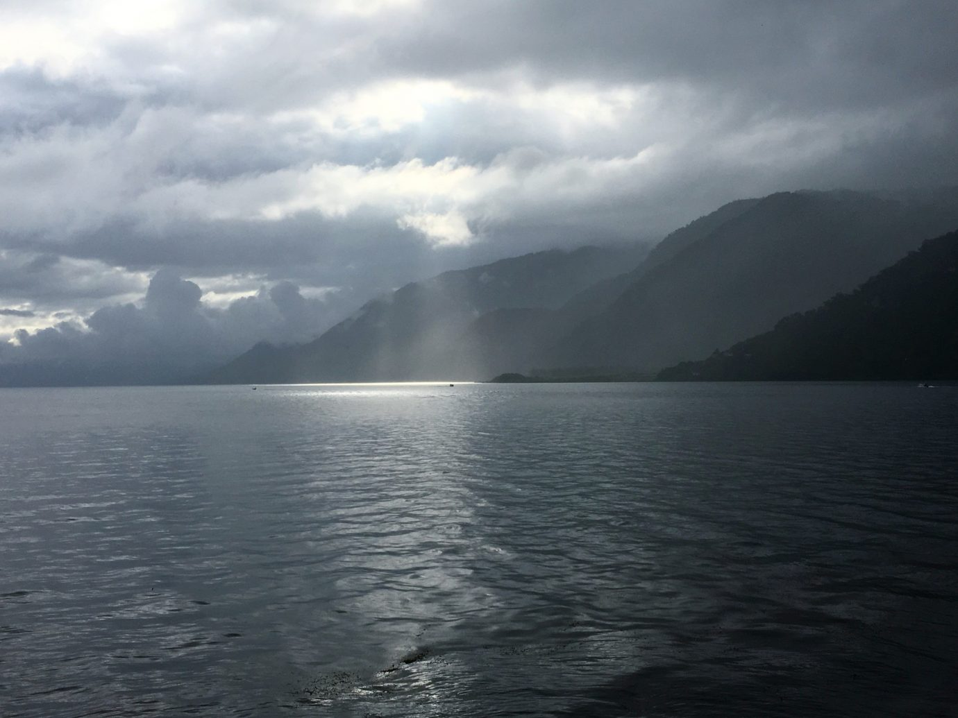 Trip Ideas water sky outdoor highland Nature Boat atmospheric phenomenon Lake loch body of water cloud horizon Sea weather fjord cloudy mountain clouds reservoir bay glacial landform promontory distance shore day