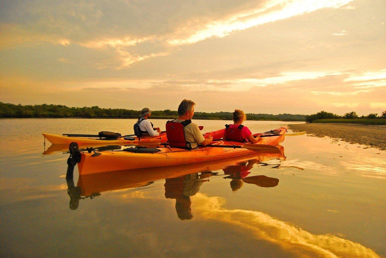 Trip Ideas water sky outdoor Boat kayak vehicle sea kayak kayaking boating watercraft transport orange watercraft rowing sports equipment Lake Sea Sunset paddle