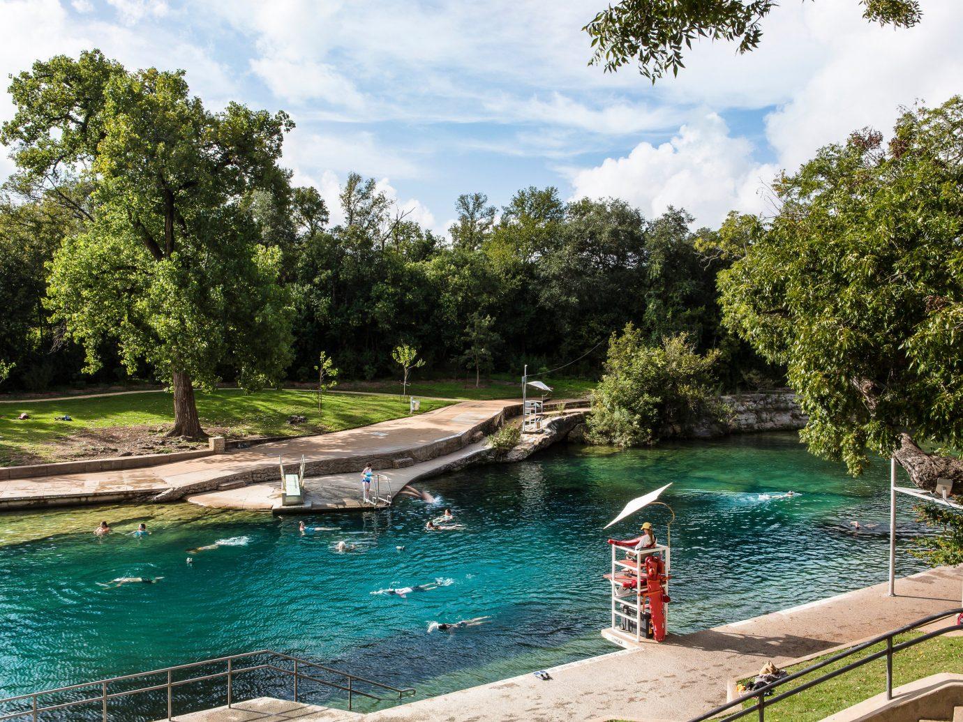 Arts + Culture Austin Nashville Trip Ideas Weekend Getaways tree outdoor water Boat swimming pool estate River Pool waterway Lake pond docked backyard shore swimming surrounded day