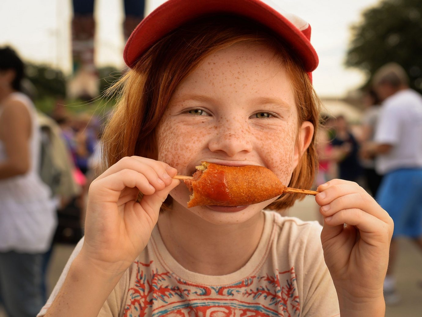 Offbeat person outdoor color human action food facial expression eating people fun smile male child snack food sandwich festival dessert