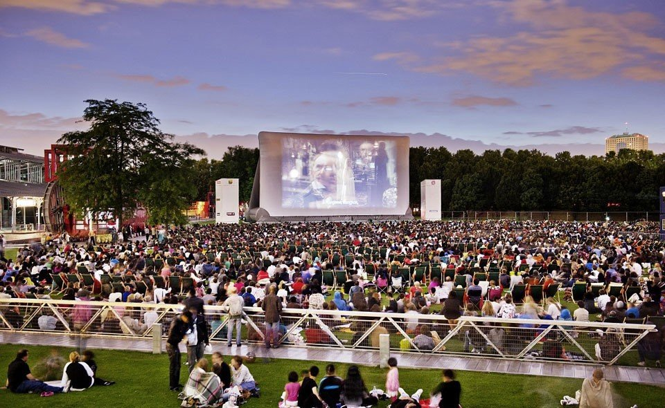 Arts + Culture person outdoor crowd people structure audience musician Sport sport venue stadium group festival arena watching