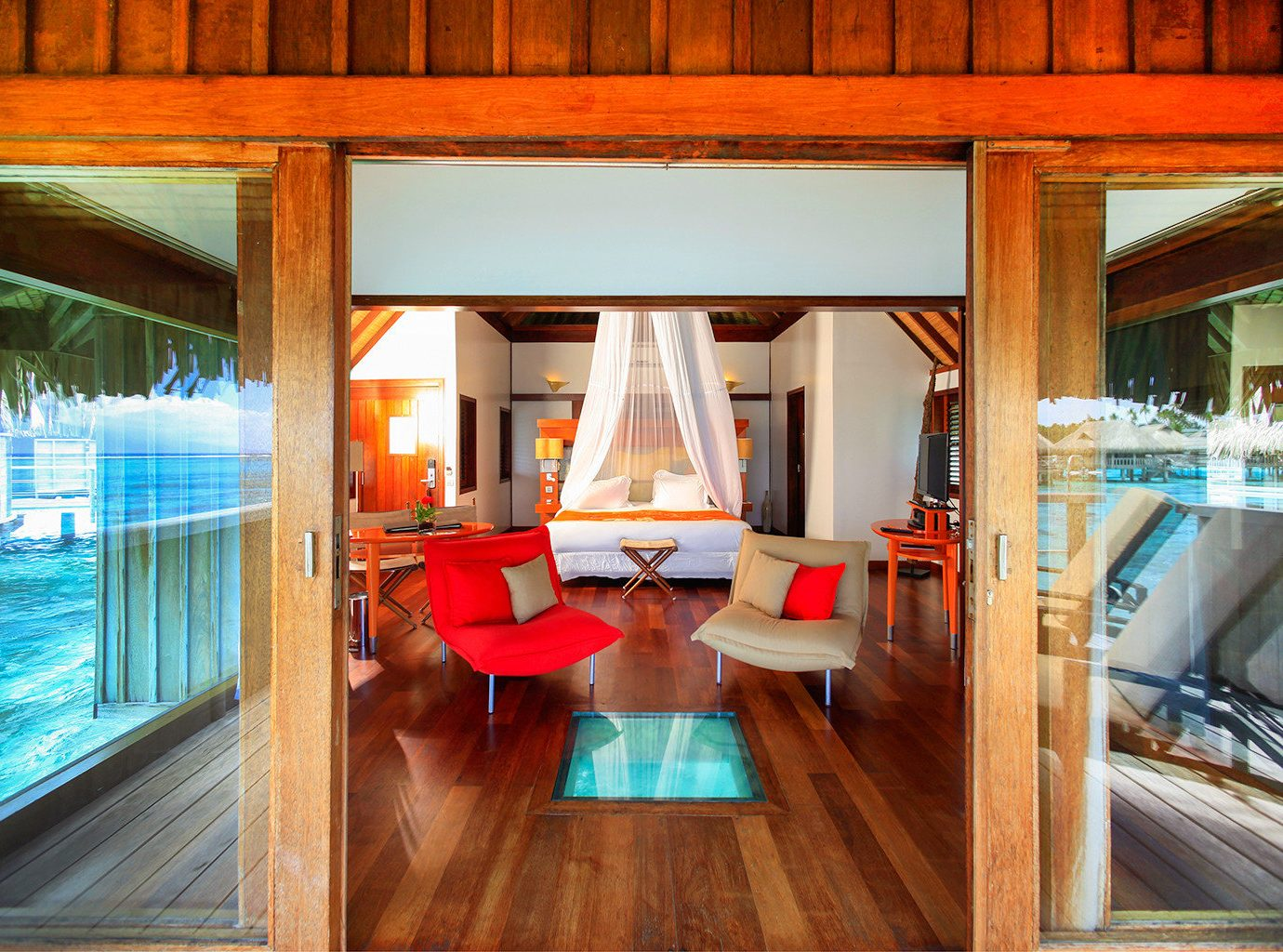 All-Inclusive Resorts Bedroom Boutique Hotels Hotels Living Luxury Overwater Bungalow Resort Romance Scenic views Trip Ideas indoor floor room property house wooden home living room estate interior design wood cottage real estate mansion Design window Villa furniture area