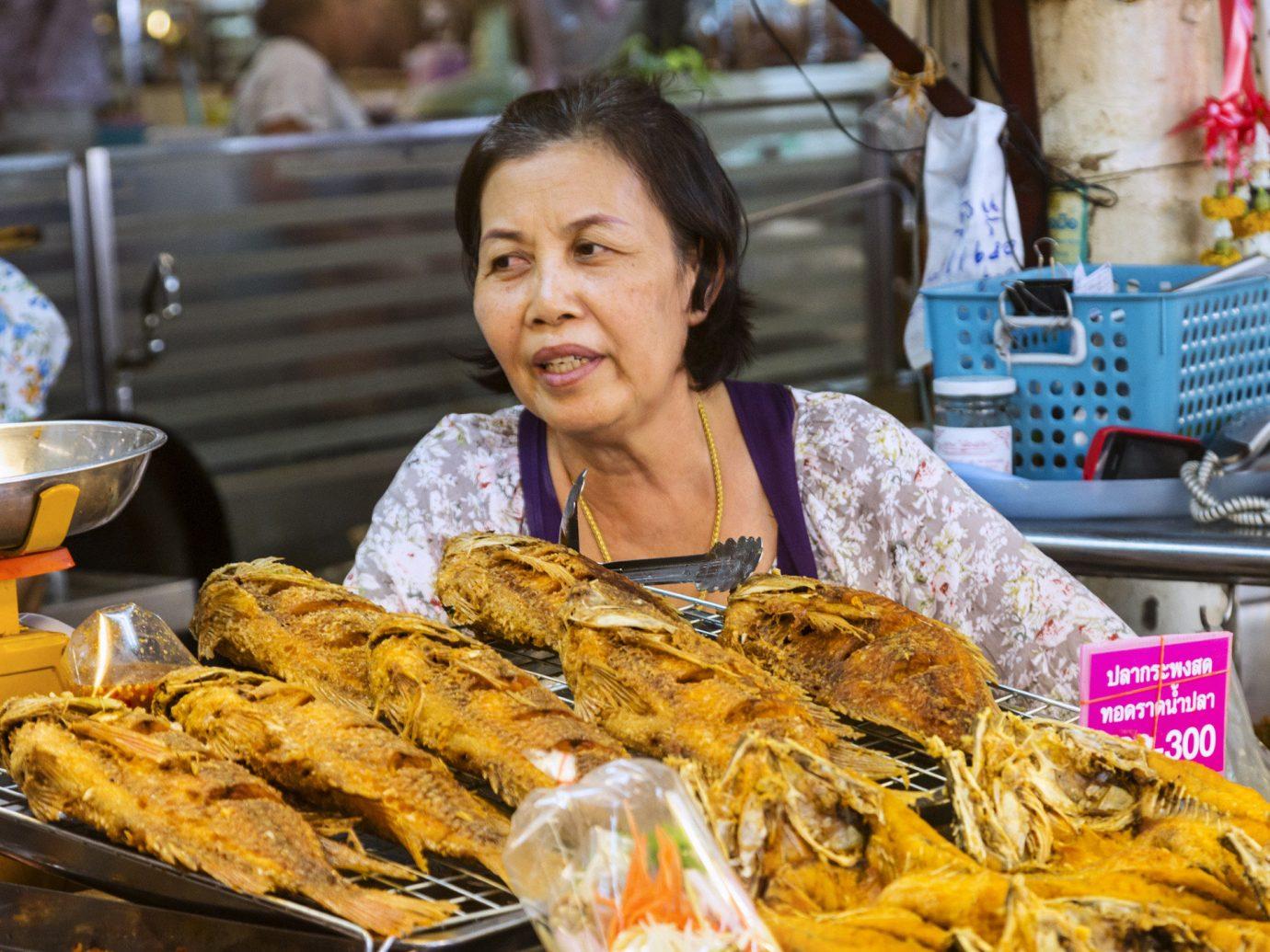 Food + Drink food person dish public space meal Seafood fish market street food cuisine sense asian food snack food