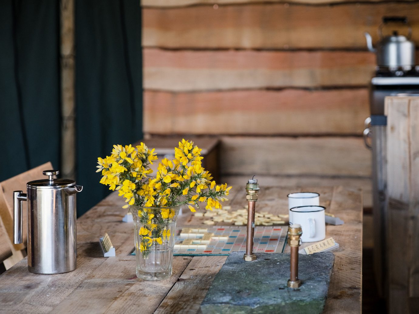 Glamping Outdoors + Adventure Trip Ideas yellow flower table home furniture wood house window plant chair floristry