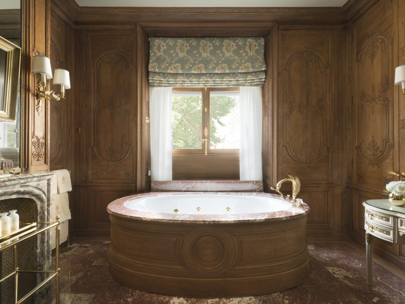 Hotels Luxury Travel indoor window room bathroom interior design estate bathtub flooring floor tub Suite Bath old stone