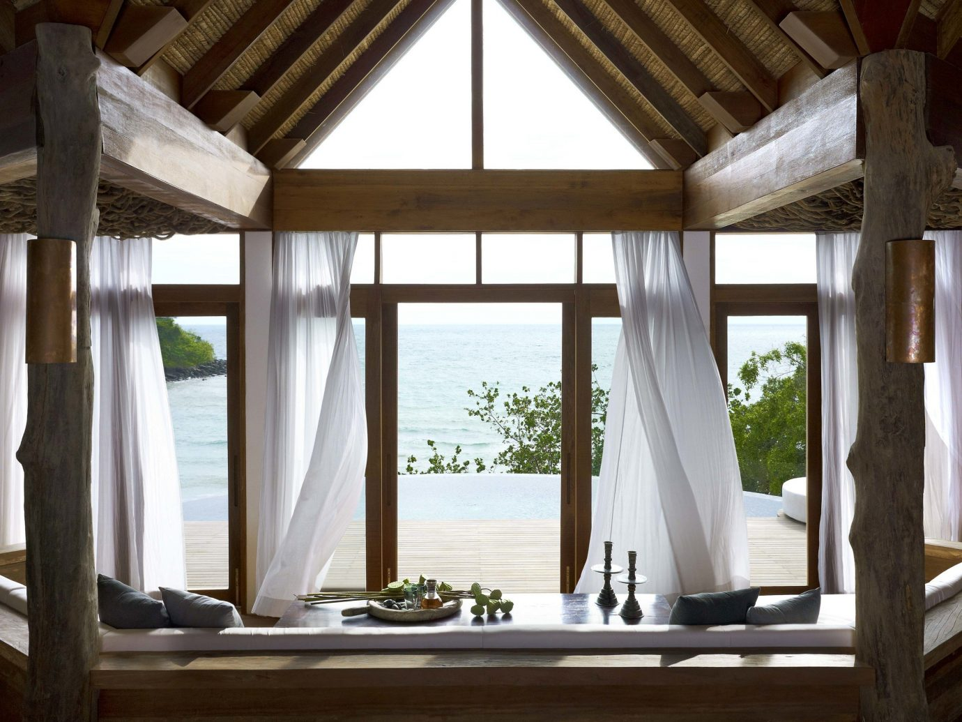 Hotels indoor room house building window porch wood home interior design estate ceiling daylighting lighting living room outdoor structure cottage window covering furniture