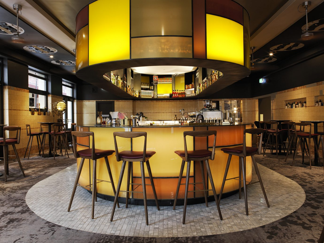 Trip Ideas chair yellow indoor man made object Lobby ceiling interior design lighting Dining Bar restaurant estate Design area