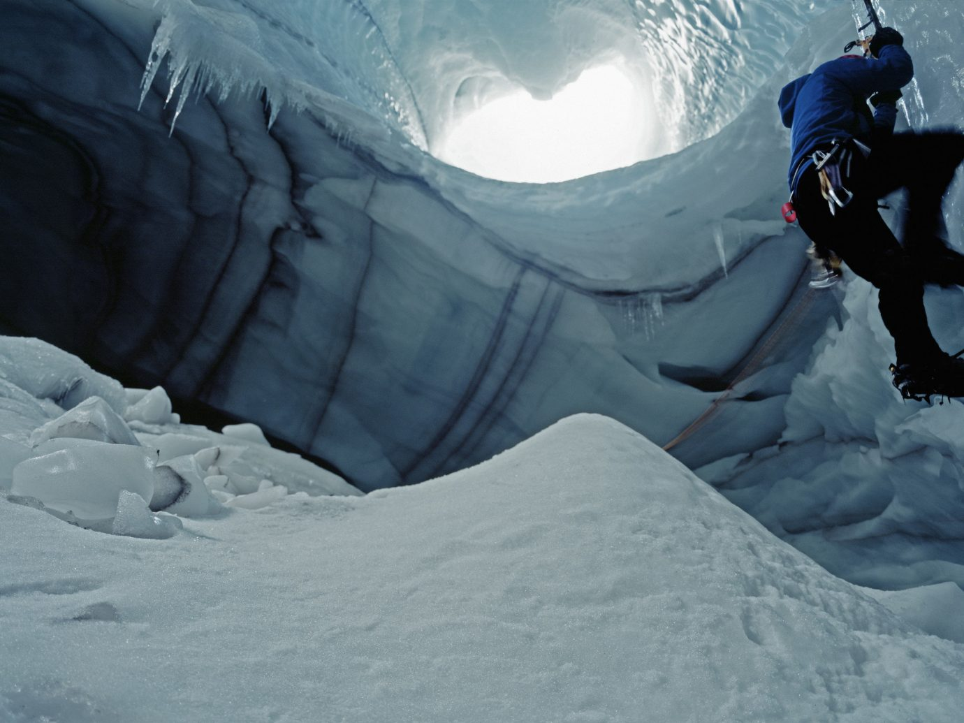 Iceland Outdoors + Adventure Trip Ideas snow Nature extreme sport ice cave Adventure ice glacial landform geological phenomenon freezing mountaineering mountaineer arctic ice cap glacier terrain polar ice cap sky ridge mountain formation summit ice climbing jumping Winter