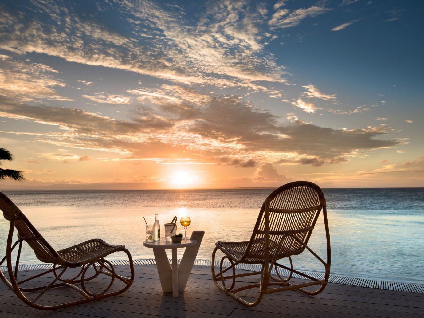 Trip Ideas water sky outdoor chair Beach Sea Sunset body of water horizon sunrise Ocean shore cloud vacation morning caribbean evening tropics calm dawn dusk Sun set overlooking sandy