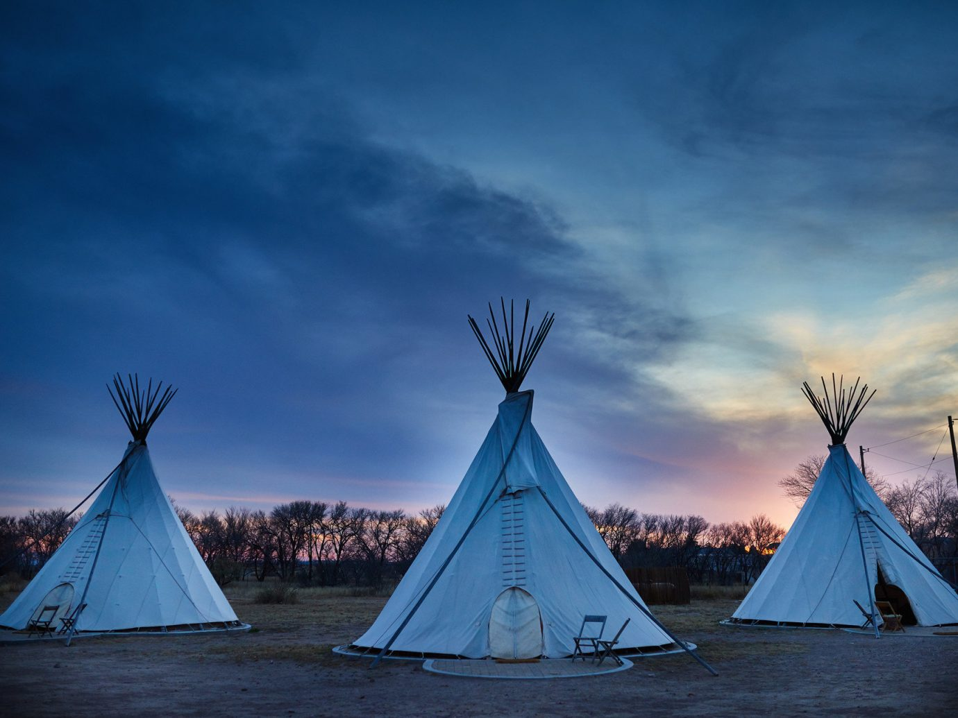 artistic artsy calm dawn dusk Exterior Glamping Hip Hotels isolation Luxury Travel Outdoors + Adventure quirky remote serene Solo Travel teepee trendy Trip Ideas Weekend Getaways tepee sky outdoor building water blue cloud light Sea horizon Winter night evening morning Ocean sunlight ice reflection Sunset lit wind several