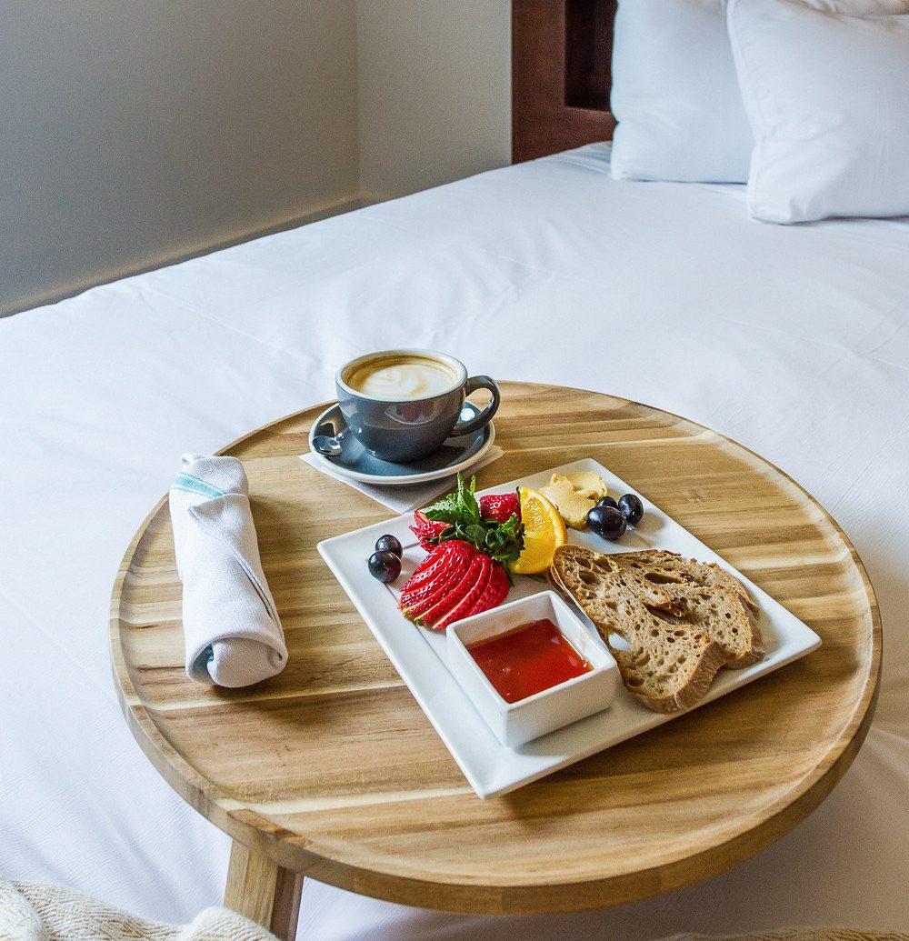 Boutique Hotels Hotels Trip Ideas table indoor meal breakfast bed tableware brunch food furniture