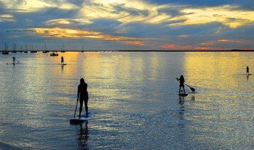 Jetsetter Guides water sky outdoor Boat scene shore horizon Sea Lake Sunset boating reflection evening paddle dusk