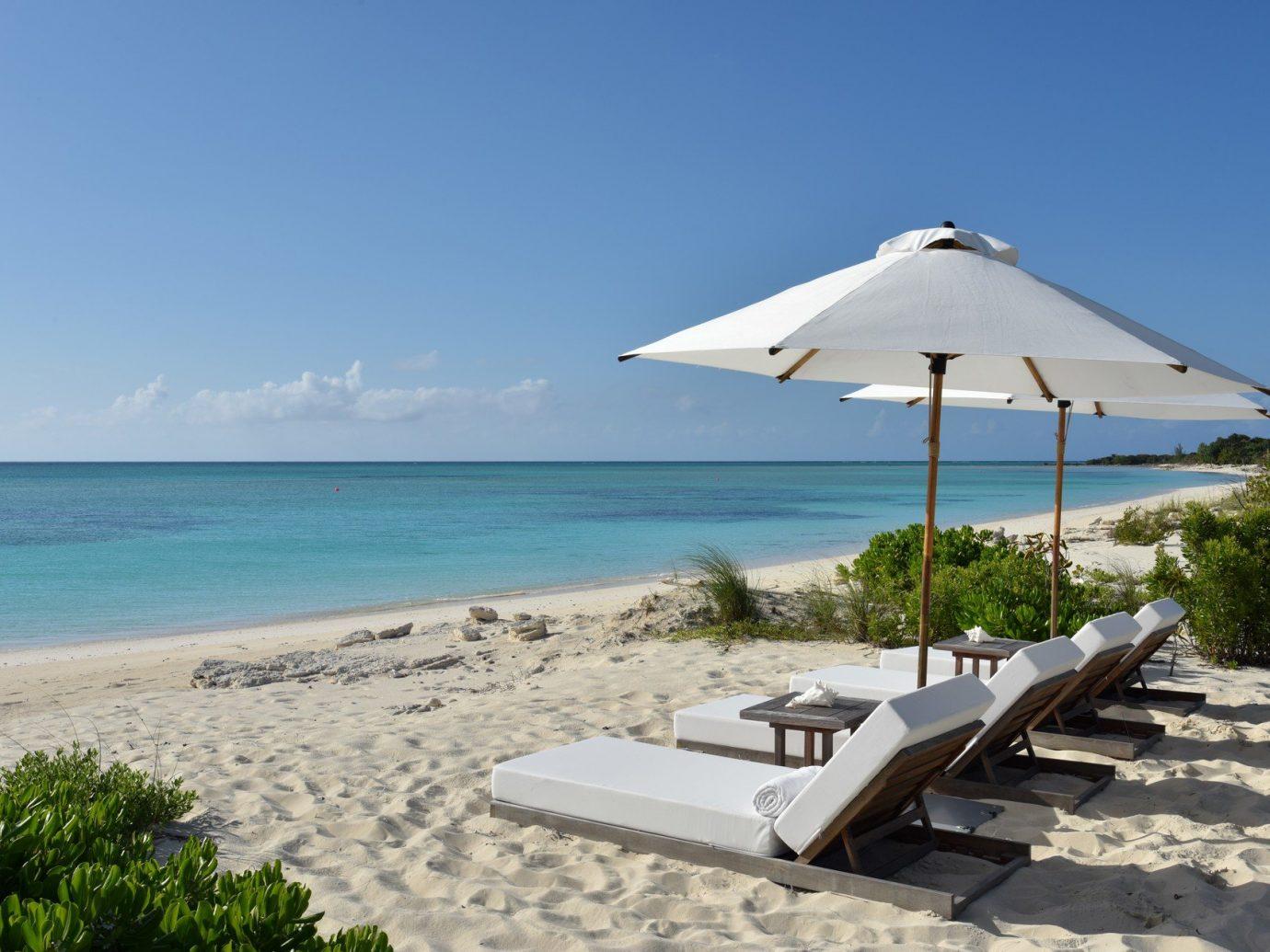 News Trip Ideas sky outdoor umbrella water Beach Nature chair Sea shore Ocean vacation Coast lawn caribbean cape bay Resort wind sandy shade day