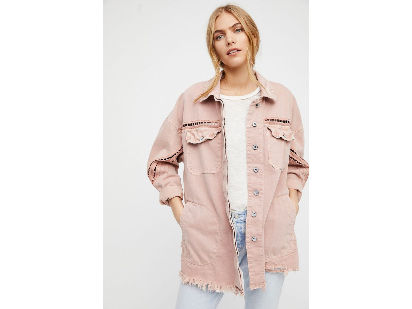 Packing Tips Spring Travel Style + Design Travel Shop clothing person standing coat wearing posing outerwear fashion model jacket sleeve beige peach dressed