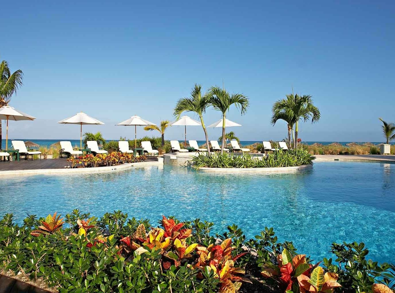 Trip Ideas water outdoor sky umbrella leisure Resort vacation swimming pool Nature tourism caribbean estate bay Sea Beach Lagoon arecales lawn Island shore lined swimming