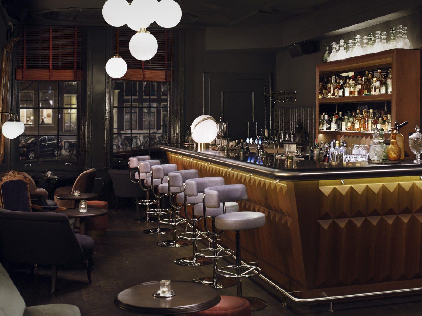 Amsterdam Boutique Hotels Hotels The Netherlands indoor ceiling room restaurant Bar meal interior design estate café table furniture