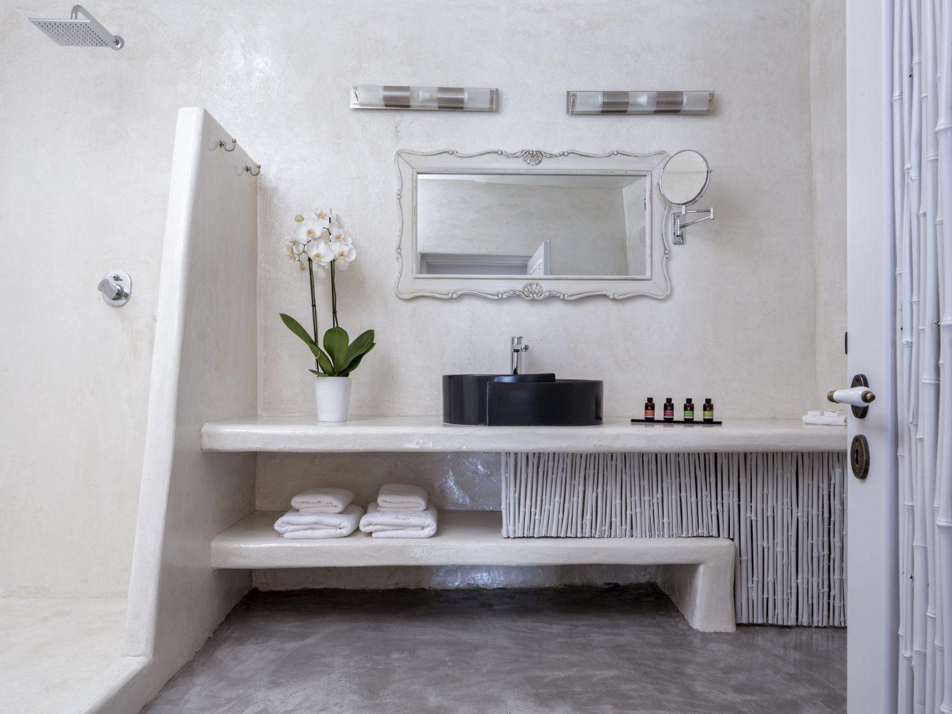 Greece Hotels Luxury Travel Santorini wall indoor bathroom room bathroom accessory sink tap floor home bathroom cabinet shelf interior design toilet plumbing fixture product design tile white flooring furniture bathroom sink shelving