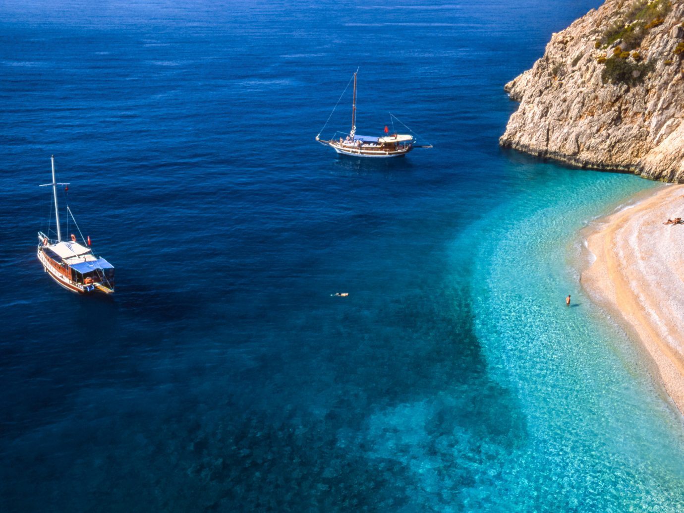 Beach water outdoor Sea coastal and oceanic landforms Boat body of water Ocean promontory Coast azure sky terrain bay calm cape Lagoon Island vacation cliff wave inlet blue shipwreck tropics Harbor cove yacht distance