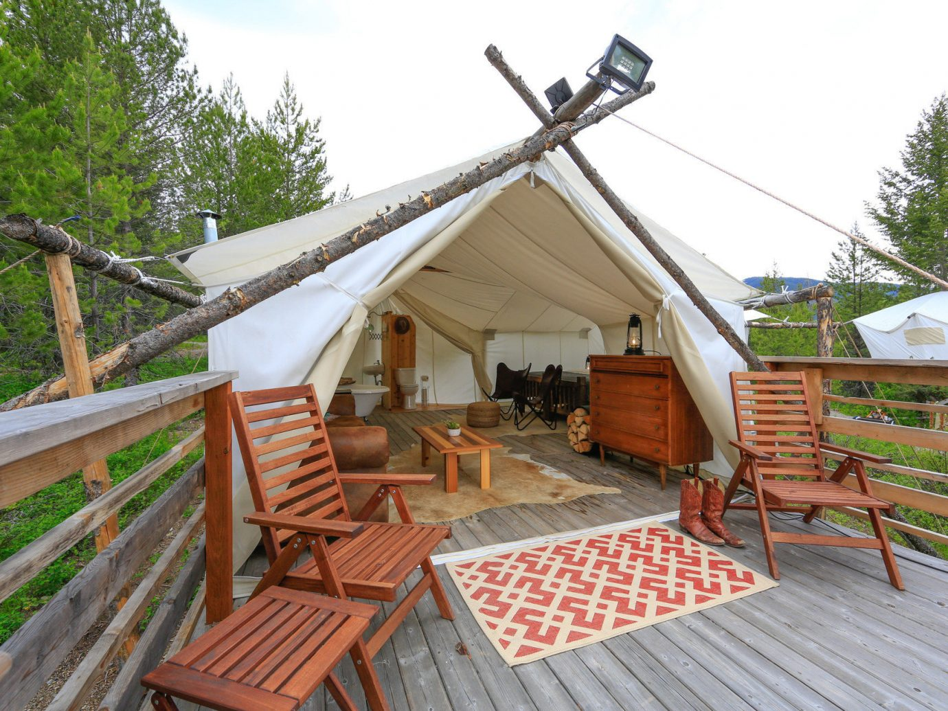 Family Travel National Parks Trip Ideas sky outdoor tree wooden chair property cottage hut Resort outdoor structure log cabin Villa real estate roof wood furniture