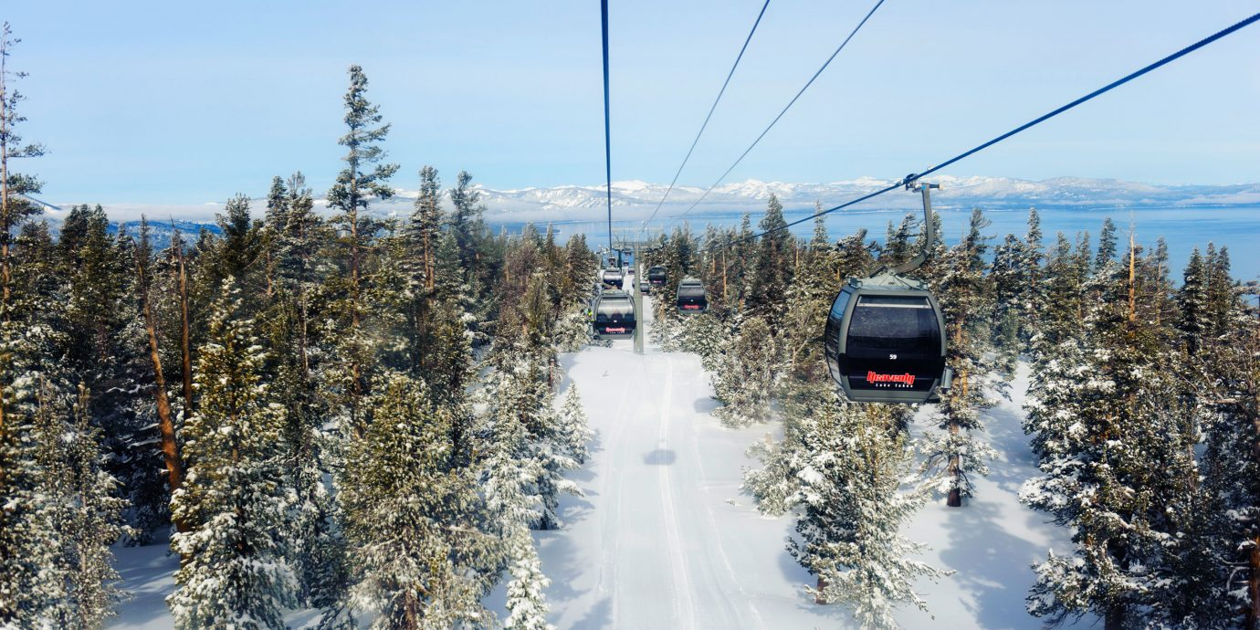 Mountains + Skiing Trip Ideas sky tree outdoor snow ski tow Winter transport weather geological phenomenon season piste winter sport nordic skiing traveling day wooded