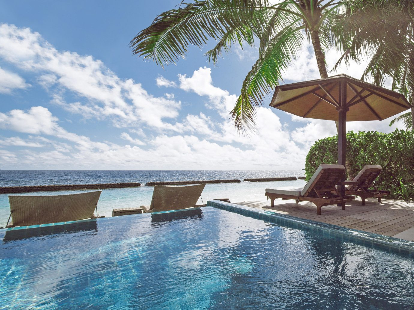 All-Inclusive Resorts Hotels outdoor tree water swimming pool Resort property Sea vacation leisure tropics palm tree sky arecales estate real estate caribbean sunlounger Villa Ocean resort town Pool outdoor furniture house tourism Lagoon condominium swimming sunny day