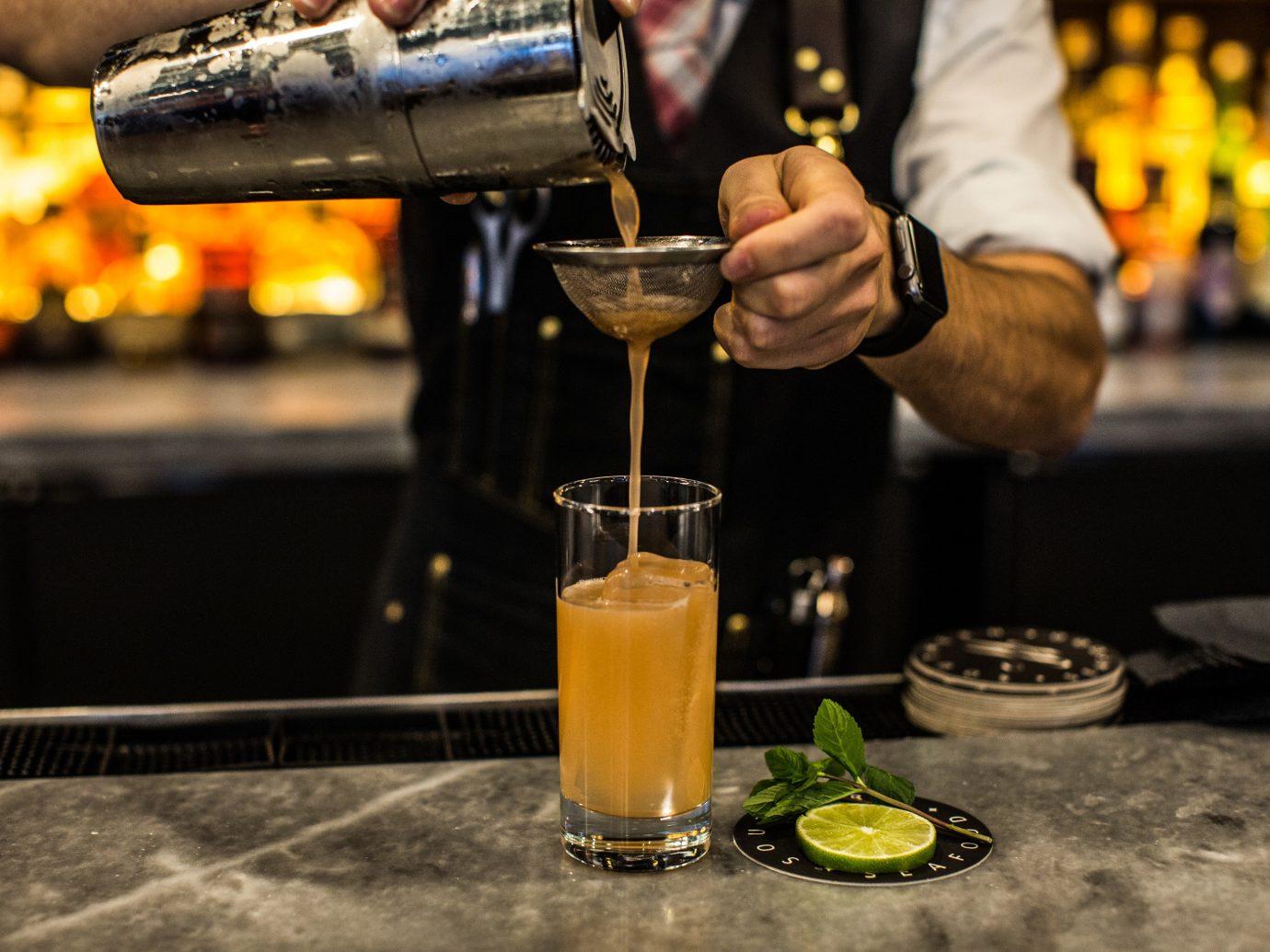 Food + Drink person Drink alcoholic beverage liqueur distilled beverage cocktail alcohol beer bartender
