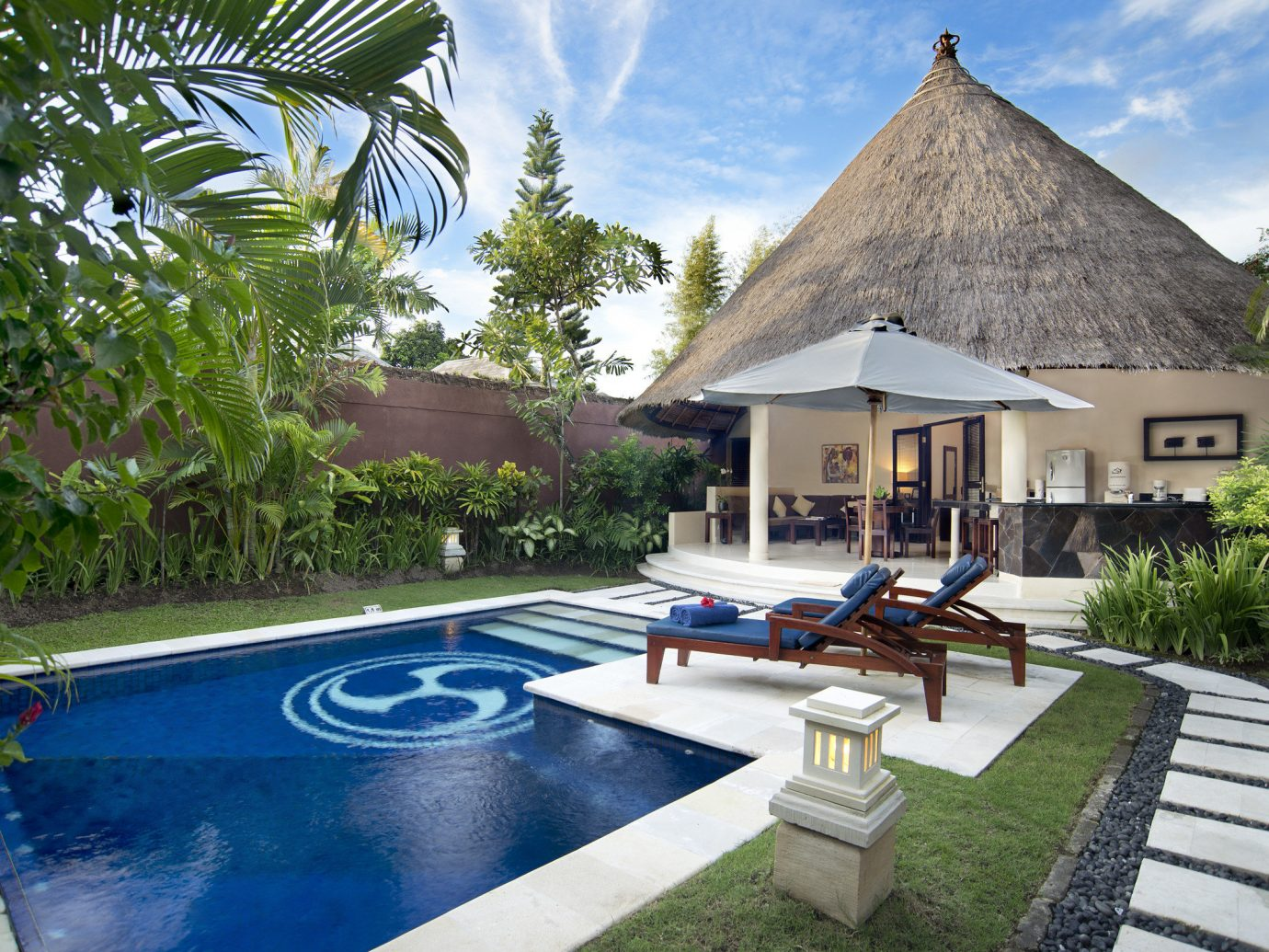Jetsetter Guides tree outdoor swimming pool property estate Resort Villa building vacation backyard home cottage real estate mansion Pool hacienda eco hotel house area stone