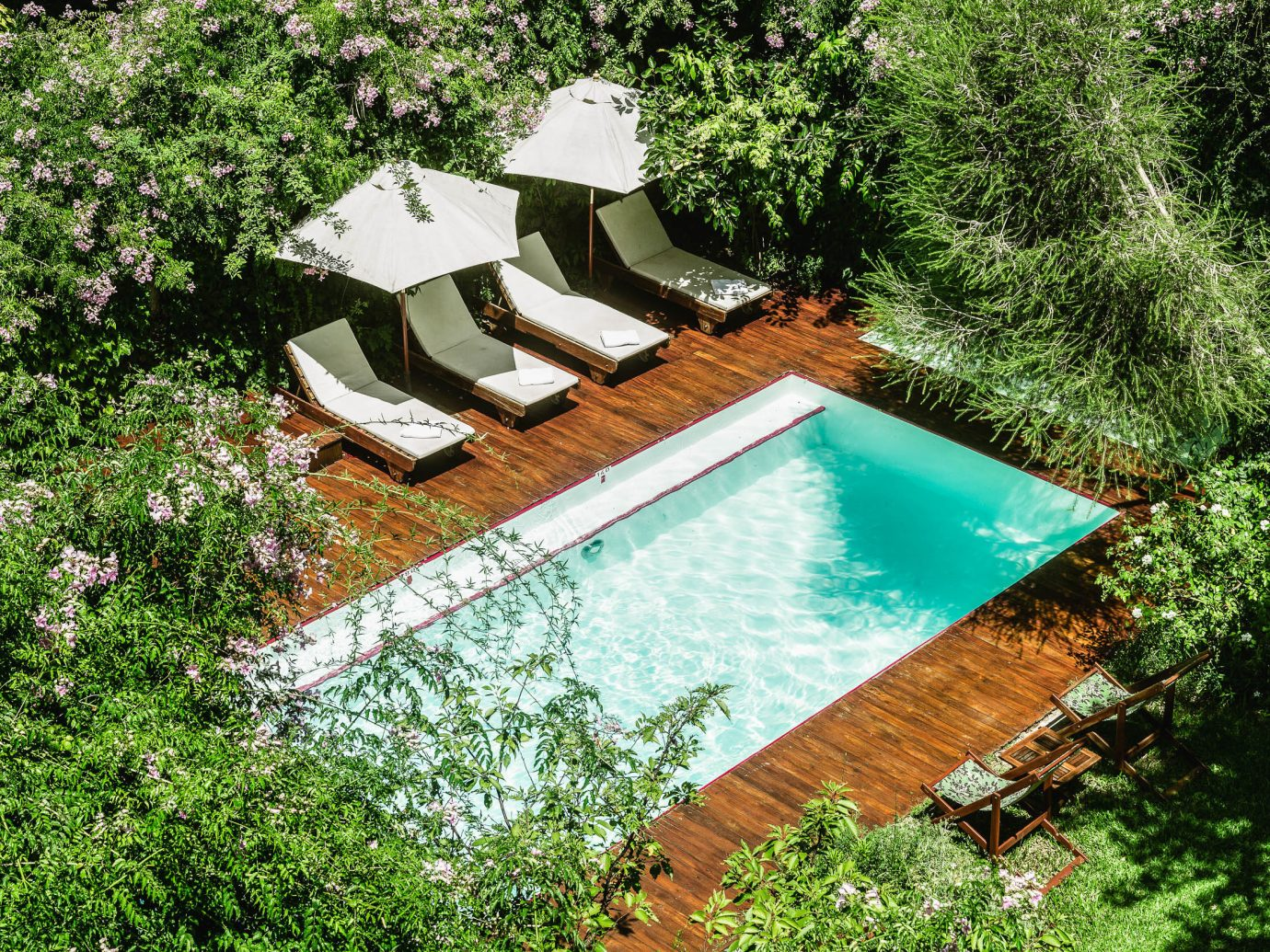 Boutique Hotels Luxury Travel Trip Ideas tree outdoor property swimming pool plant house backyard water outdoor structure real estate leisure estate yard landscaping Garden cottage grass roof landscape