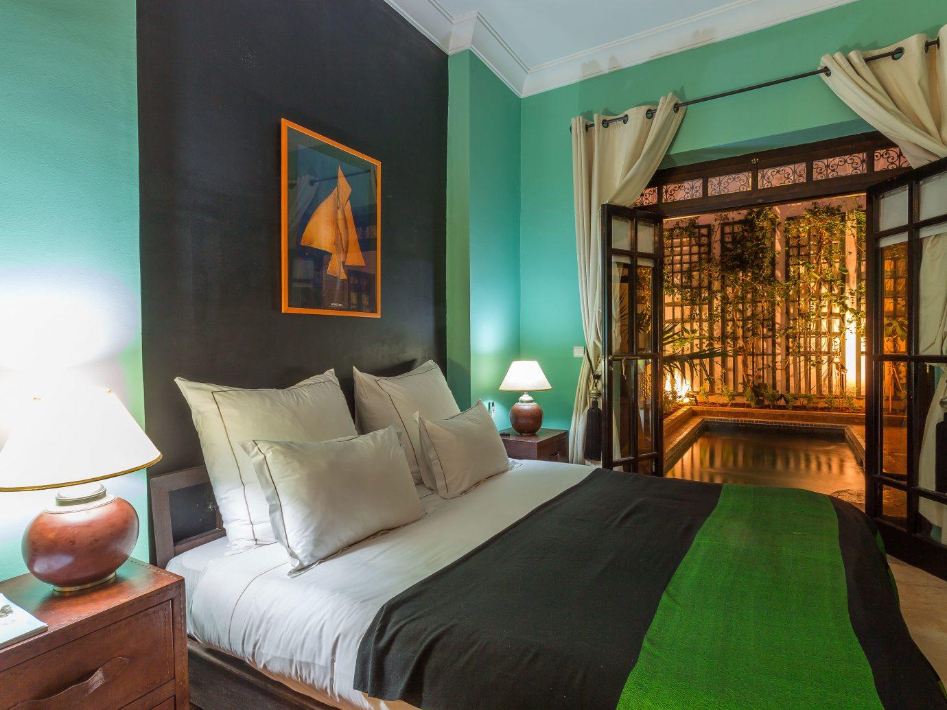 Bedroom Hip Hotels indoor wall room bed green property living room estate home cottage Suite interior design real estate Villa hotel decorated furniture