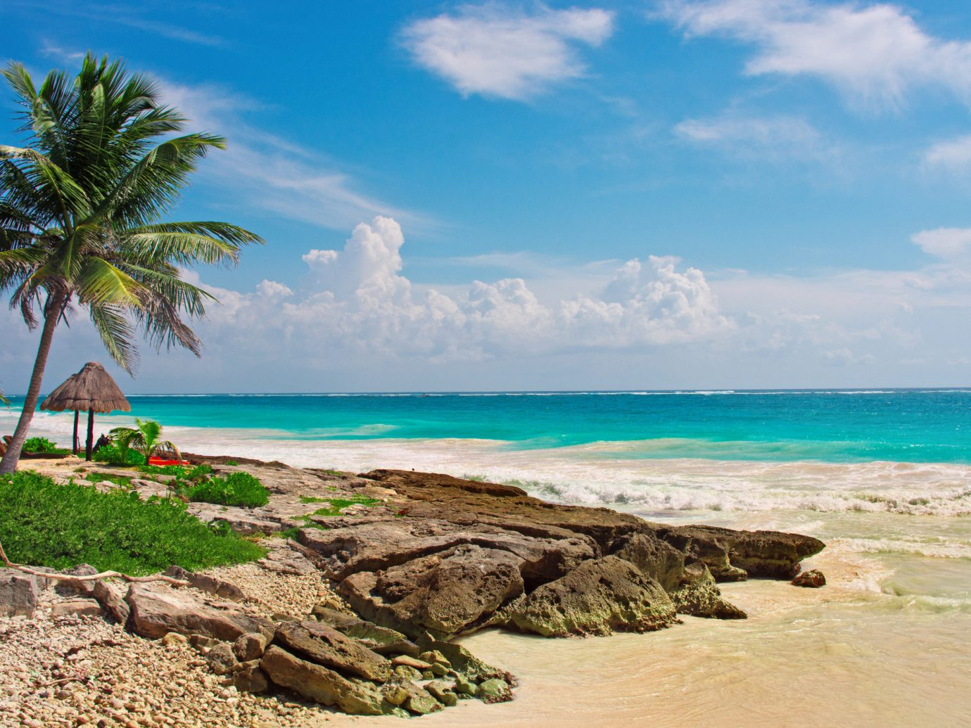Travel Tips outdoor sky water Nature Sea Beach body of water tropics shore Coast Ocean caribbean coastal and oceanic landforms arecales palm tree cloud palm rock tree tourism vacation bay promontory Island islet horizon sand landscape sandy day