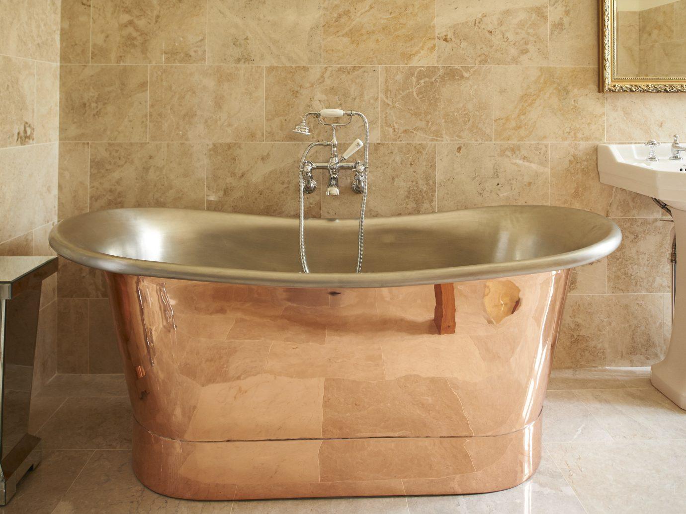 Trip Ideas wall indoor floor man made object room bathtub bathroom sink plumbing fixture bidet stone tub Bath water basin tan