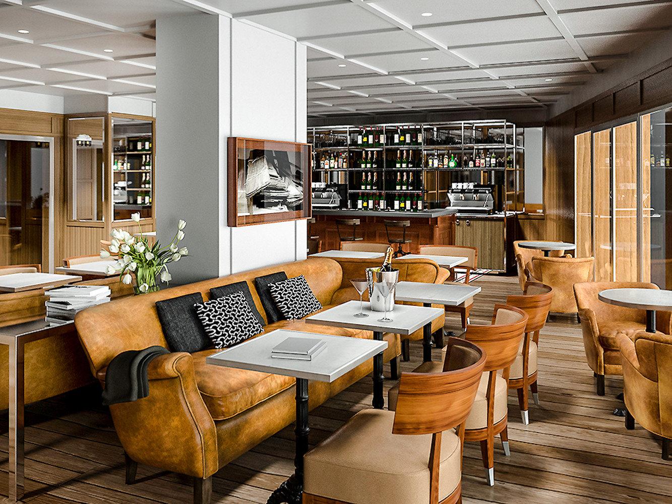 Boutique Hotels Hotels Luxury Travel indoor floor table chair room ceiling window interior design furniture restaurant café area several