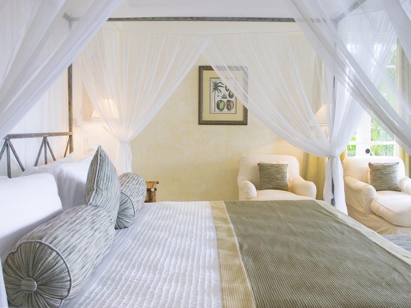 Bedroom Trip Ideas indoor bed room property cottage estate Suite interior design white real estate Villa living room Resort