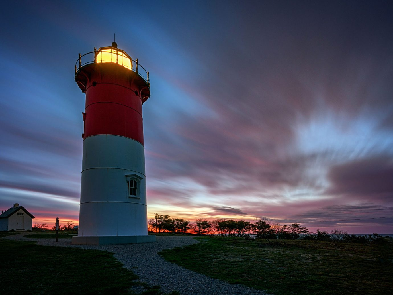 Trip Ideas sky outdoor lighthouse building tower night light cloud Sea Sunset evening dusk dawn Coast distance