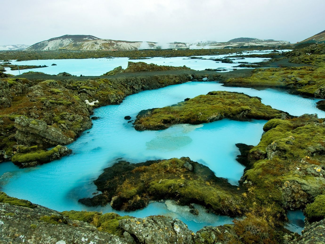 Hotels Iceland Trip Ideas water sky rock grass outdoor Nature landform geographical feature body of water natural environment rocky Coast loch tarn Sea landscape reflection aerial photography Lake crater lake stream national park surrounded pond hillside