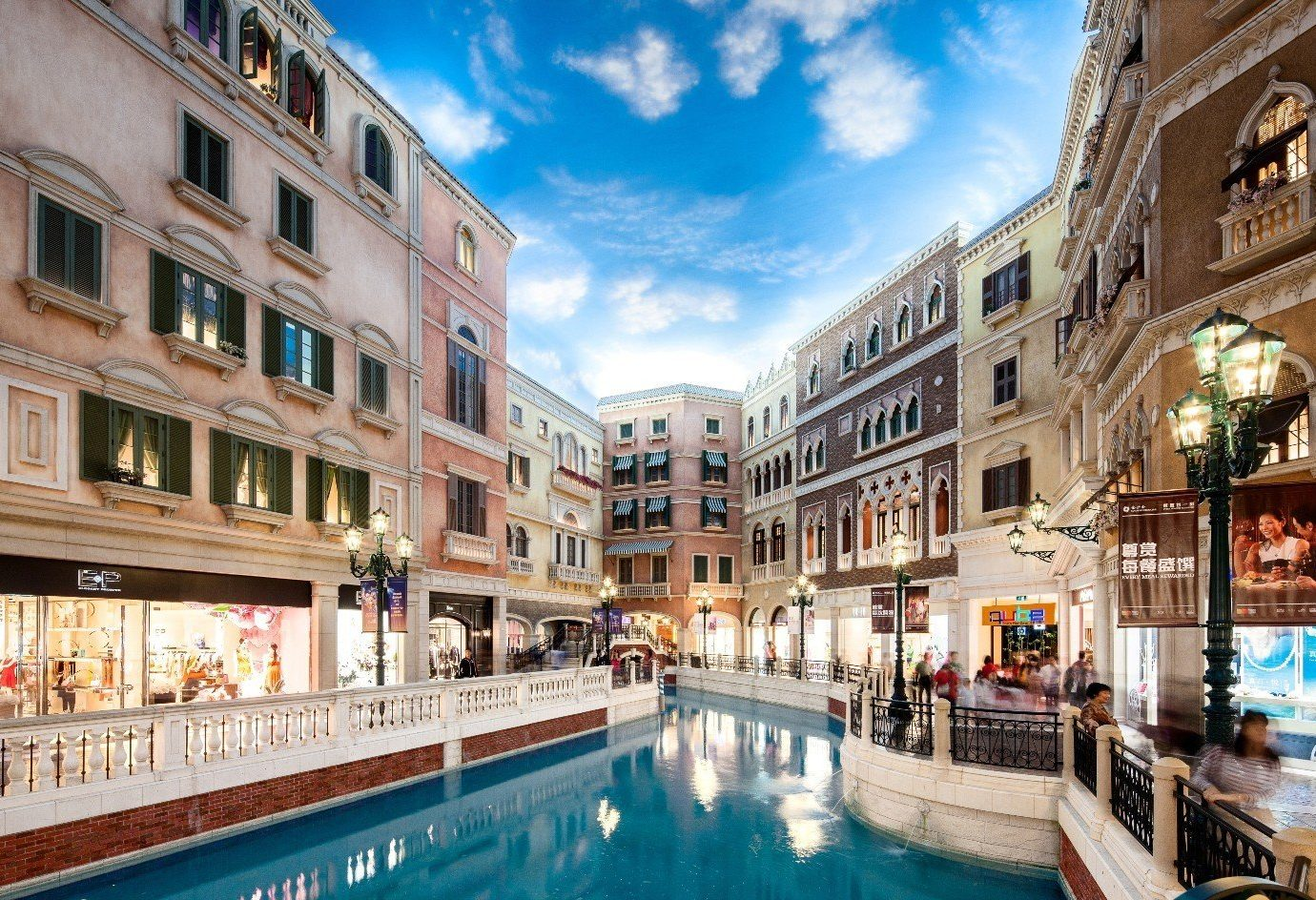 Hotels building outdoor geographical feature plaza Town landmark waterway vacation tourism cityscape town square Downtown Canal City estate palace