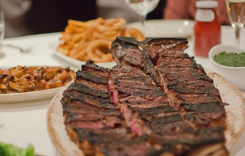 Food + Drink food plate table dish meat indoor steak meal roast beef cuisine animal source foods rib eye steak snack food several