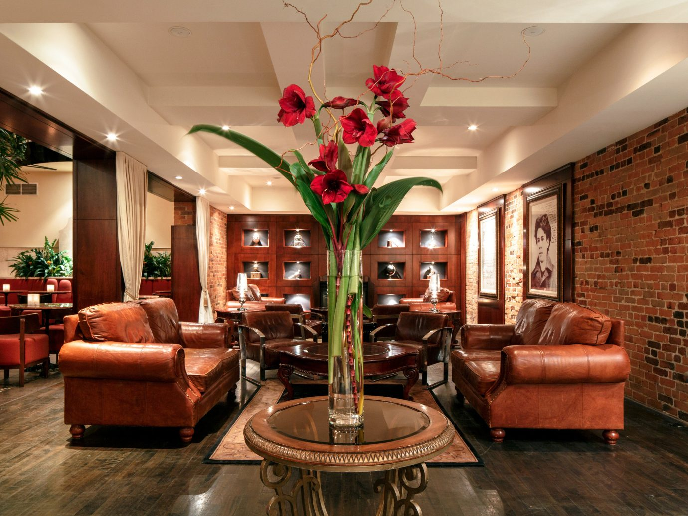 Living Lobby Lounge Luxury Trip Ideas Weekend Getaways Winter indoor floor wall ceiling room dining room living room property furniture estate home interior design hardwood Fireplace real estate plant Design mansion window covering area stone leather wood
