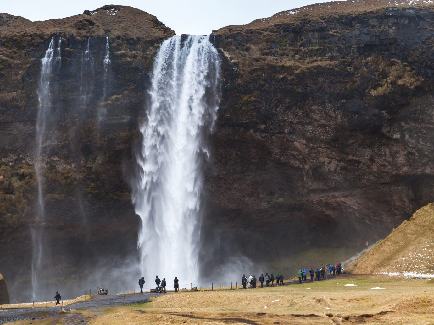 Iceland Outdoors + Adventure Road Trips Waterfall body of water water water resources chute water feature watercourse escarpment hill station mountain geology formation landscape